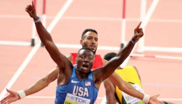 USA's Grant Holloway celebrates after winning the Men's 110 Hurdles final at the 2019 IAAF Athletics