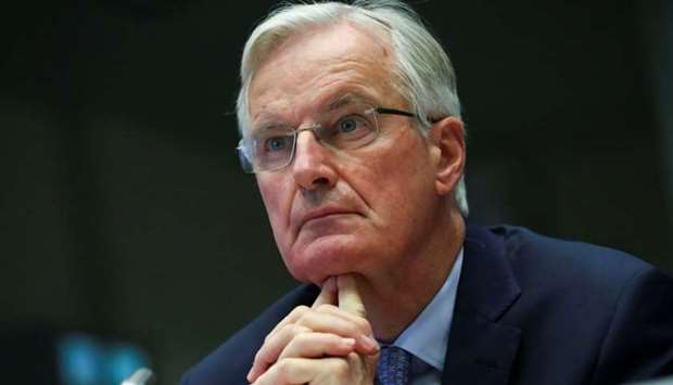 The European Union's Brexit negotiator Michel Barnier looks on as he addresses the European Economic