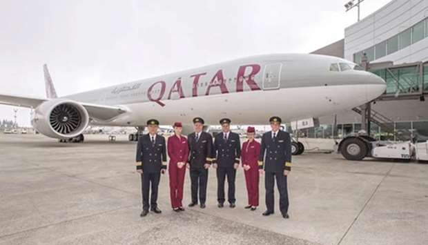 Qatar Airways cockpit and cabin crew with the airline's 50th Boeing 777. May 9, 2016 file picture.