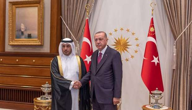 Turkish President Recep Tayyip Erdogan with HE the Prime Minister and Minister of Interior Sheikh Ab