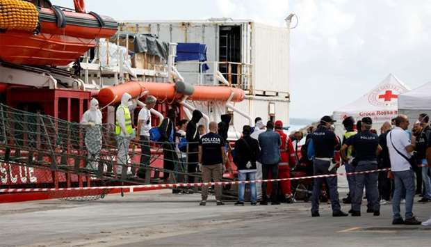 Migrants disembark at the port of Pozzallo on the island of Sicily, Italy