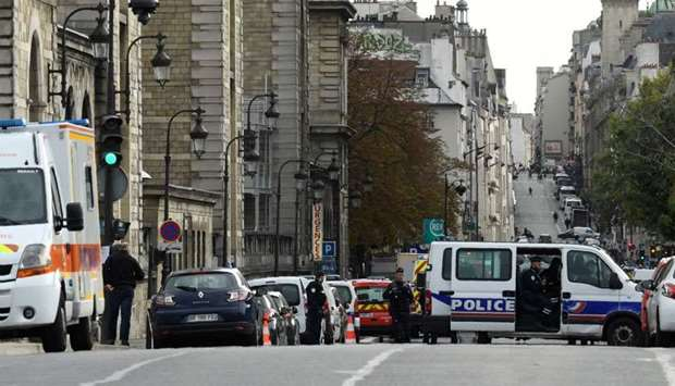 Police officers stand guard the streets near Paris prefecture de police (police headquarters) after