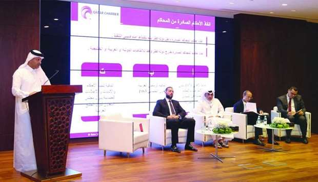 Hilal Mohamed al-Khulaifi addressing the seminar; Sheikh Dr Thani bin Ali al-Thani looks on.