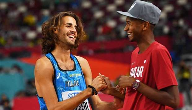 Qatar's Mutaz Essa Barshim talks with Italy's Gianmarco Tamberi