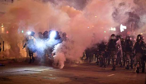 Riot police fire tear gas at protesters at Causeway Bay area in Hong Kong as people hit the streets
