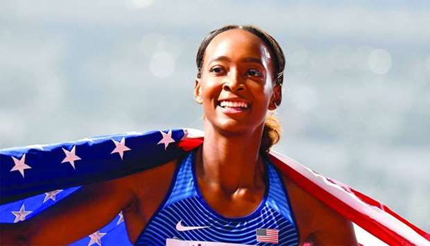 USA's Dalilah Muhammad celebrates with the national flag after winning the Women's 400m Hurdles fina