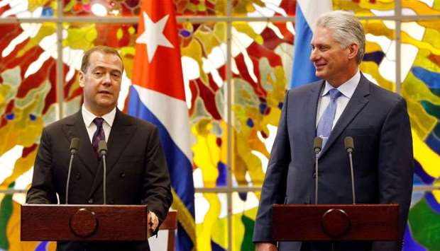 Cuba's President Miguel Diaz-Canel watches Russia's Prime Minister Dmitry Medvedev as he speaks at t