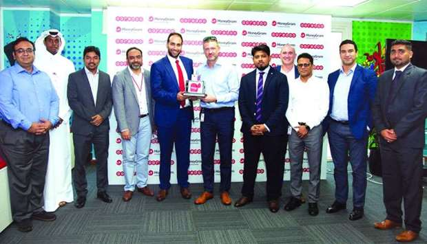 Ooredoo senior officials receiving the award during a recently-held ceremony