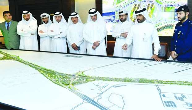 Dignitaries and officials being briefed on the new Tilted Interchange. PICTURE: Ram Chand