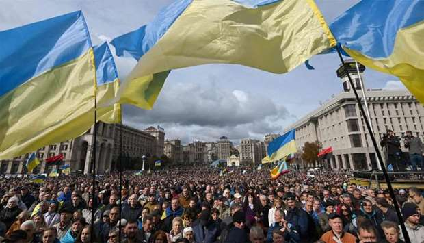 Demonstrators wave Ukraine national flags as they gather in central Kiev to protest broader autonomy