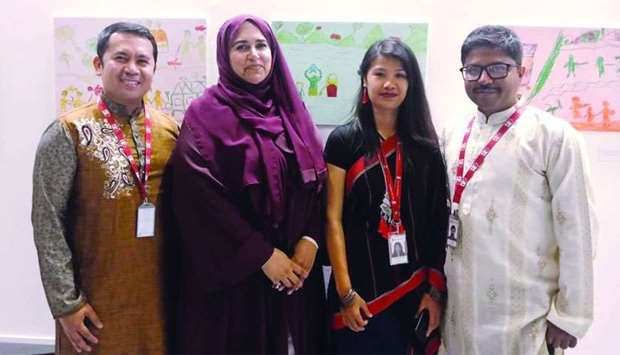 (From left) Aladin Borja with WISH CEO Sultana Afdhal and other Save the Children team members at th