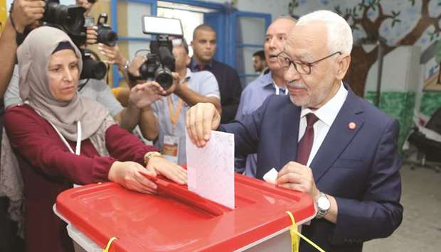 Ennahda Party leader Rached Ghannouchi casts his ballot at a polling station in the capital Tunis, y