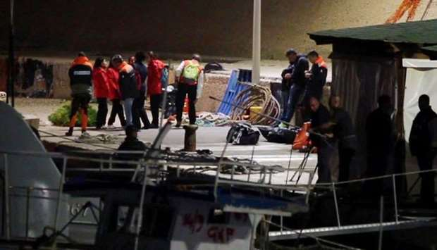Survivors rescued by the Italian coastguard after their ship carrying migrants began taking on water