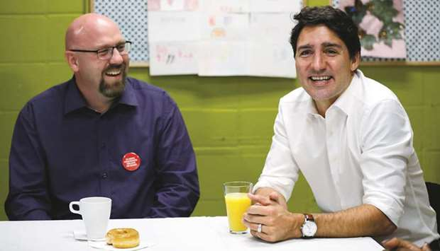 Liberal leader and Canadian Prime Minister Justin Trudeau meets teachers during an election campaign