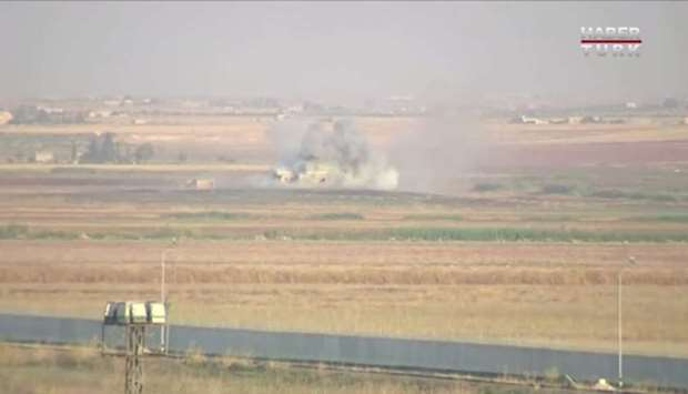 Smoke rises from an explosion in the border town of Tel Abyad, Syria, as seen from Akcakale, Turkey