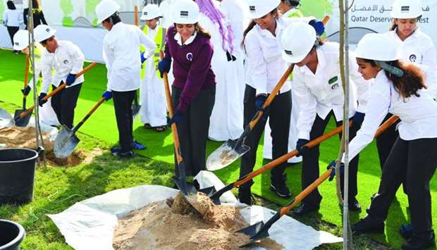 Students taking part in 'Qatar Beautification and Our Kids Planing Trees' campaign