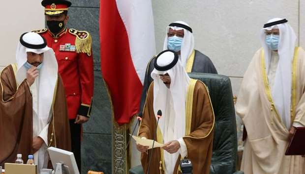 Sheikh Nawaf al-Ahmad Al-Sabah (C) reads a statement after being sworn in as Kuwait's new Amir at th