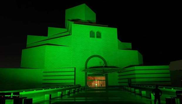 Museum of Islamic Arts lit in green to mark World Mental Health Day.