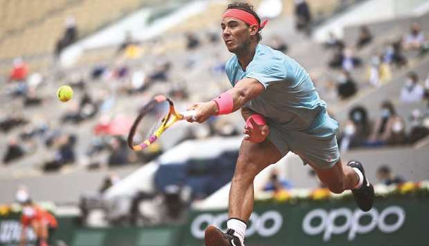 Spain's Rafael Nadal returns the ball to Mackenzie McDonald (not pictured) of the US during their Fr