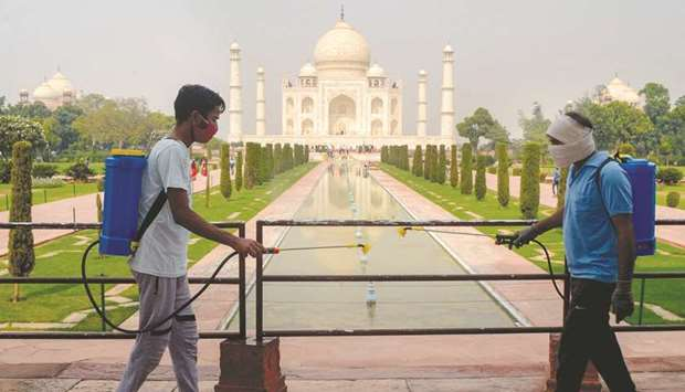 Workers sanitise the premises of Taj Mahal as a preventative measure against the Covid-19 in Agra ye