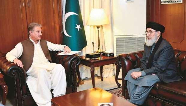 Foreign Minister Shah Mahmood Qureshi (left) with veteran Afghan politician and Hezb-i-Islami leader