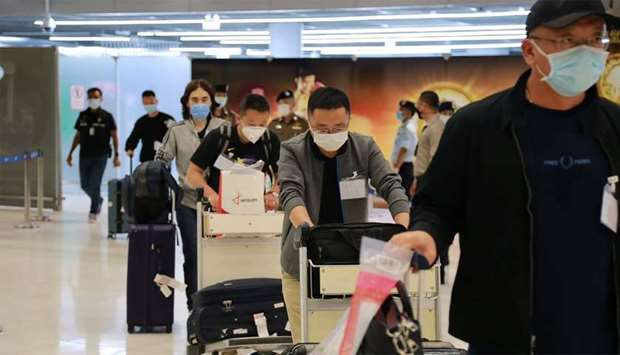 A group of 39 Chinese visitors with special tourist visas at Suvarnabhumi Airport in Bangkok