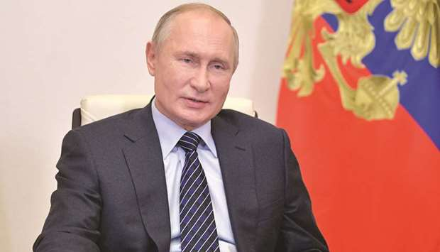Russia's President Vladimir Putin addresses members of the Russian Union of Industrialists and Entre