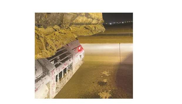 The officials found that the material being transported leaking onto the road from the truck.