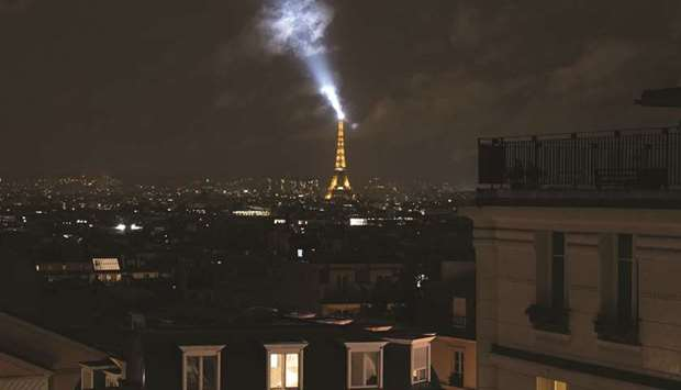 The Eiffel Tower is seen at night during the curfew in Paris.