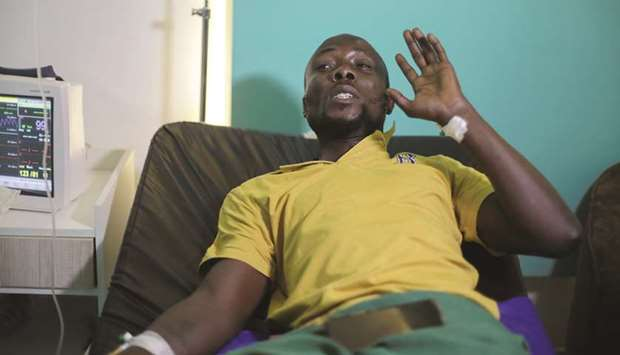 Injured man David Ivwrogbo speaks while in his hospital bed during an interview, in Lagos, yesterday