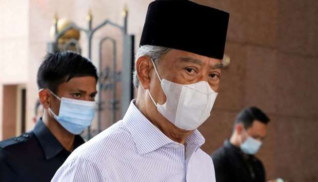 Malaysia's Prime Minister Muhyiddin Yassin wearing a protective mask arrives at a mosque for prayers