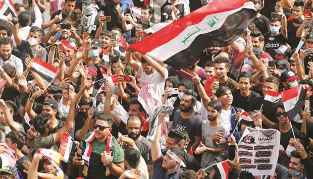 Iraqi demonstrators gather to mark the first anniversary of the anti-government protests in Baghdad,