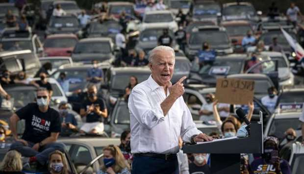 Democratic presidential nominee Joe Biden speaks during a drive-in campaign rally in the parking lot