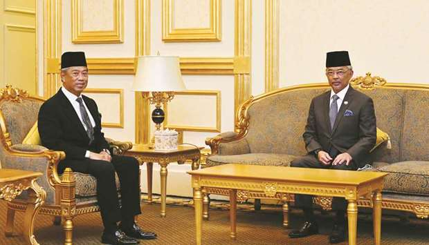 Malaysia Prime Minister Muhyiddin Yassin (left) posing for pictures with Malaysia's King Sultan Abdu