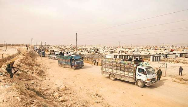 A convoy of trucks transporting Syrian women and children suspected of being related to Islamic Stat