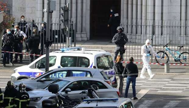 French members of the elite tactical police unit RAID enter to search the Basilica of Notre-Dame de