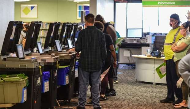 Voters cast their early ballots at the Miami Dade Regional Library in Miami, Florida