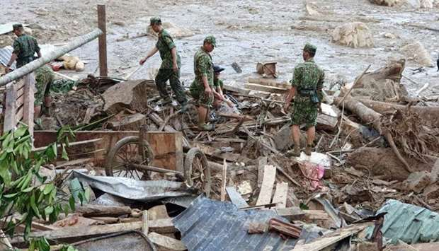 Rescue team search for victims of a landslide in Quang Nam province, Vietnam
