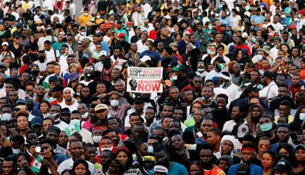 Demonstrators gather during a protest over alleged police brutality in Lagos, Nigeria
