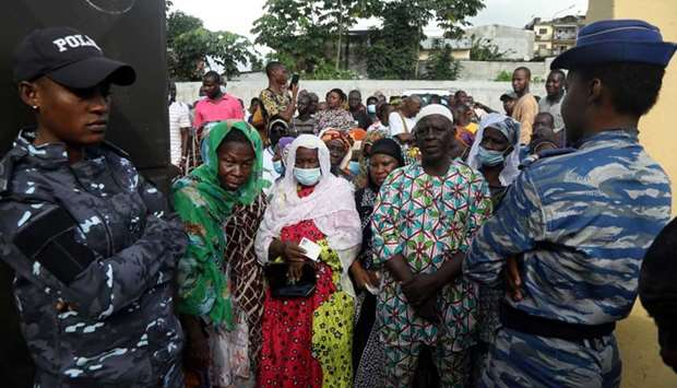 People wait to cast their votes during the presidential election in Abidjan, Ivory Coast