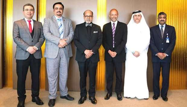 """Doha Bank Group CEO Dr. R. Seetharaman with other officials. Doha Bank has been """"recommended to cont"""
