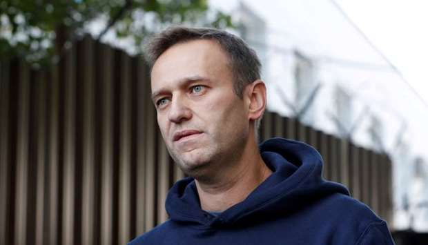 Russian opposition leader Alexei Navalny speaks with journalists after he was released from a detent