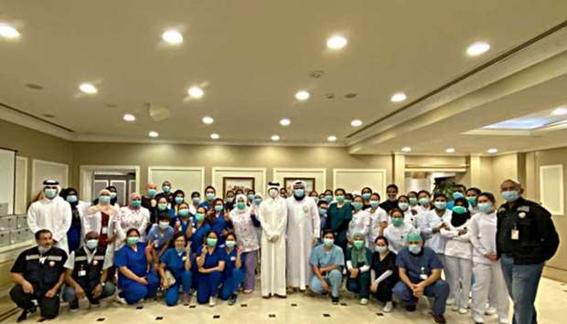 Qatar Care staff with officials