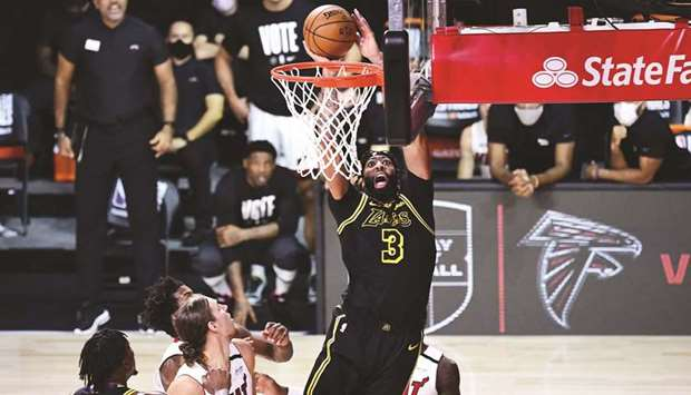 Anthony Davis of the Los Angeles Lakers drives to the basket during the second half against the Miam