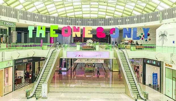 The experience encompasses a large 3D sticker on the floor and hanging art pieces.