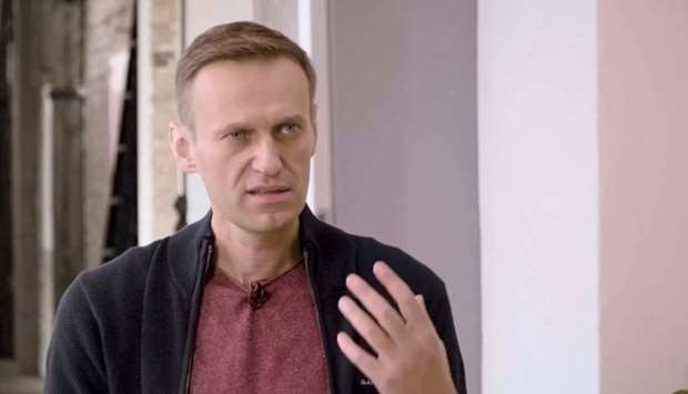Russian opposition politician Alexei Navalny speaks during an interview with prominent Russian YouTu