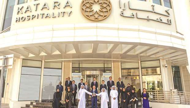 Katara Hospitality officials and employees with the Safety Excellence Award.