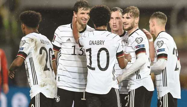 Germany's forward Timo Werner (second right) celebrates with teammates after scoring his team's seco