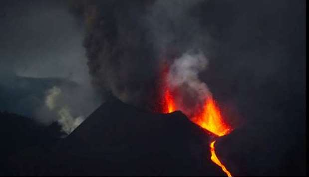 The Cumbre Vieja volcano spews lava and smoke as it continues to erupt on the Canary Island of La Pa