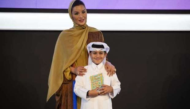 QF chairperson Her Highness Sheikha Moza bint Nasser with a winner of the Akhlaquna Award. Credit Ai